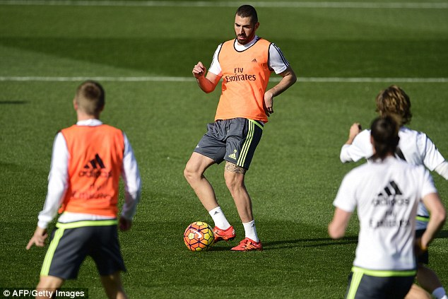 Karim Benzema, who could start despite his well-publicized off-field problems, passes the ball