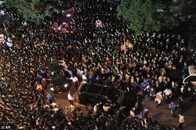 Saying goodbye: The close-knit Hasidic community said goodbye to the boy in a funeral in Borough Park on July 13, 2011; the crime rocked the Jewish sect to the core