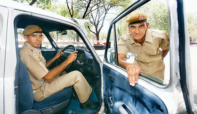 Behind the wheel: LLB graduates Lokesh Kumar and Jitender Singh who passed out from the Delhi Police Training School to become Driver Constables