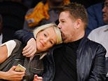 LOS ANGELES, CA - NOVEMBER 22:  James Corden (R) and his wife Julia Carey attend basketball game between the Portland Trail Blazers and the Los Angeles Lakers at Staples Center on November 22, 2015 in Los Angeles, California.  (Photo by Noel Vasquez/GC Images)