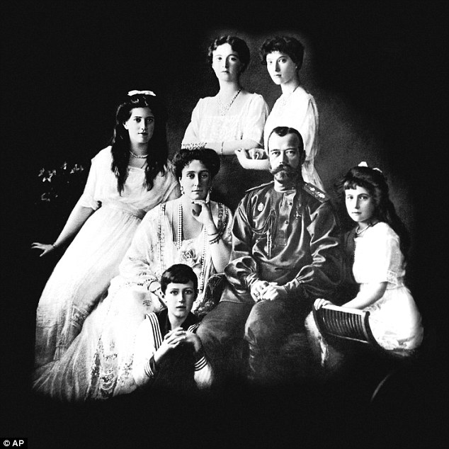 Last Russian imperial family in 1913: Alexei is pictured in the foreground while Maria, Czarina Alexandra Fyodorovna, Czar Nicholas II and Anastasia are left to right in the first row. Olga, left, and Tatiana, right are pictured in the second row