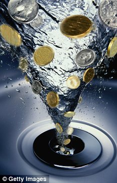 Coins going down drain in a vortex of water