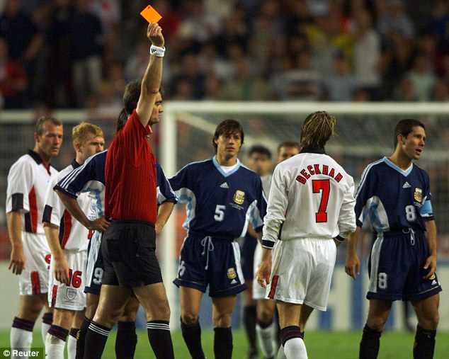 Infamous: Beckham is sent off for kicking out at Argentina's Diego Simeone during the 1998 World Cup