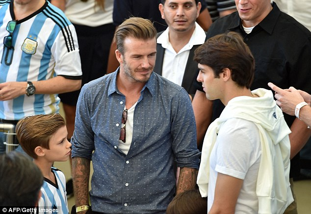 Support: David Beckham was at the Maracana with his three sons for the World Cup final - and all three were kitted out in Argentina shirts as they prepared to take on Germany. Here, Beckham chats with Kaka, his former team-mate at Milan
