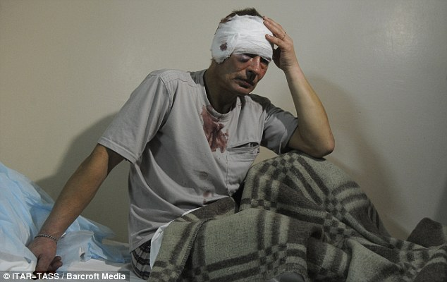 Wounded: A man, who has sustained injuries to his head, arrives at hospital following the blast