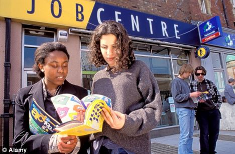Teenagers check out leaflets at a Job Centre.