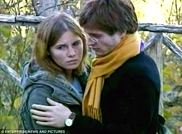Suspects: Amanda Knox pictured with Raffaele Sollecito shortly after Meredith Kercher's murder