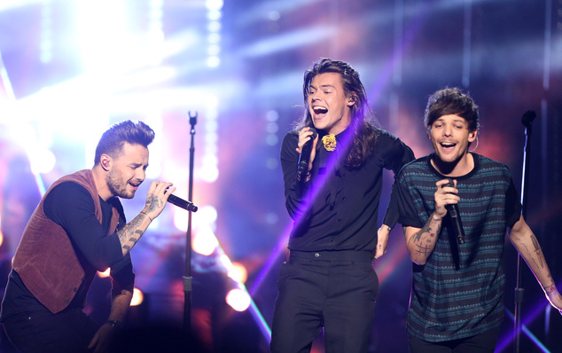 Liam Payne, from left, Harry Styles, and Louis Tomlinson of One Direction perform at the American Music Awards at the Microsoft Theater on Sunday, Nov. 22, 2...