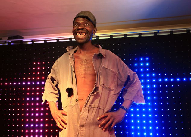 Mison Sere smiles after winning the 2015 edition of the Mr Ugly competition, in Harare, Saturday, Nov. 21.2015.  Sere who controversially dethroned  former M...