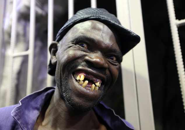 Mison Sere smiles after winning the 2015 edition of the Mr Ugly competition, in Harare, Saturday, Nov. 21.2015. Sere who controversially dethroned  former Mr...