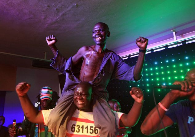 Mison Sere reacts, top, after winning the  2015 edition of the Mr Ugly competition, in Harare, Saturday, Nov. 21.2015.  The competition was won by Mison Sere...