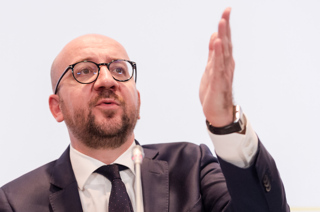 Belgium's Prime Minister Charles Michel addresses the media after a National Security Council meeting in Brussels on Sunday, Nov. 22, 2015. Authorities will ...