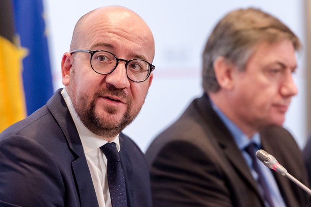 Belgium's Prime Minister Charles Michel, left, and Interior Minister Jan Jambon address the media after a National Security Council meeting in Brussels on Su...