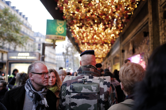A soldier patrols in front of the Galeries Lafayette department store in Paris over a week after the start of the Paris attacks, Sunday, Nov. 22, 2015. Frenc...