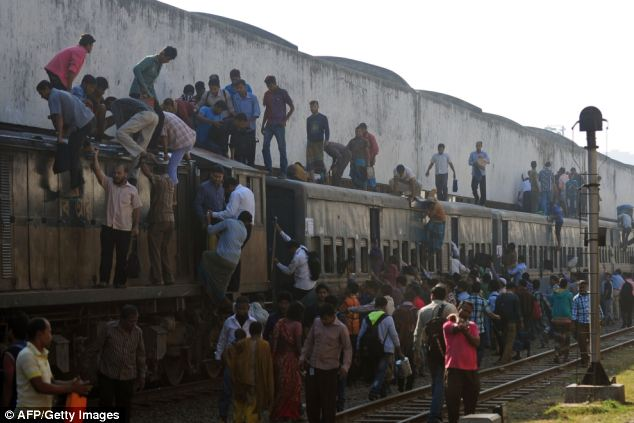 Bangladeshi commuters leave from a train during an ongoing blockade organised by Bangladesh Nationalist Party (BNP) activists and its Islamist allies in Dhaka