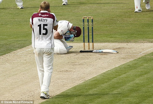 Devastated: Kieswetter (bottom) was struck in the face off the bowling of David Willey (top) on Saturday