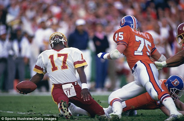 Ouch: QB Doug Williams (17) hyperextended his knee in the Redskins 42-10 victory over the Denver Broncos