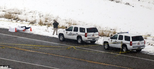Investigations: Law enforcement officials examined the scene following the shooting on SR-73 in Eagle Mountain on Thursday