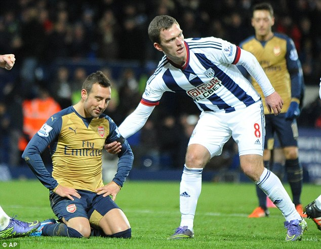 West Brom's Craig Gardner (right) helps the Spaniard to his feet after his missed penalty
