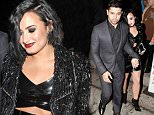 Wilmer Valderrama & Girlfriend Demi Lovato hold hands as they leave a restaurant in Los Angeles.  Pictured: Wilmer Valderrama, Demi Lovato Ref: SPL1183313  231115   Picture by: Bello  Splash News and Pictures Los Angeles: 310-821-2666 New York: 212-619-2666 London: 870-934-2666 photodesk@splashnews.com