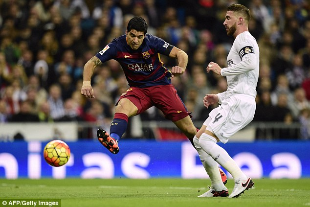 Luis Suarez (left) fires home the opener for Barcelona as they shocked arch-rivals Real Madrid