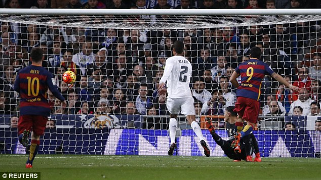 Suarez delightfully lifts the ball over Navas to make it four as Barca ran riot in Madrid