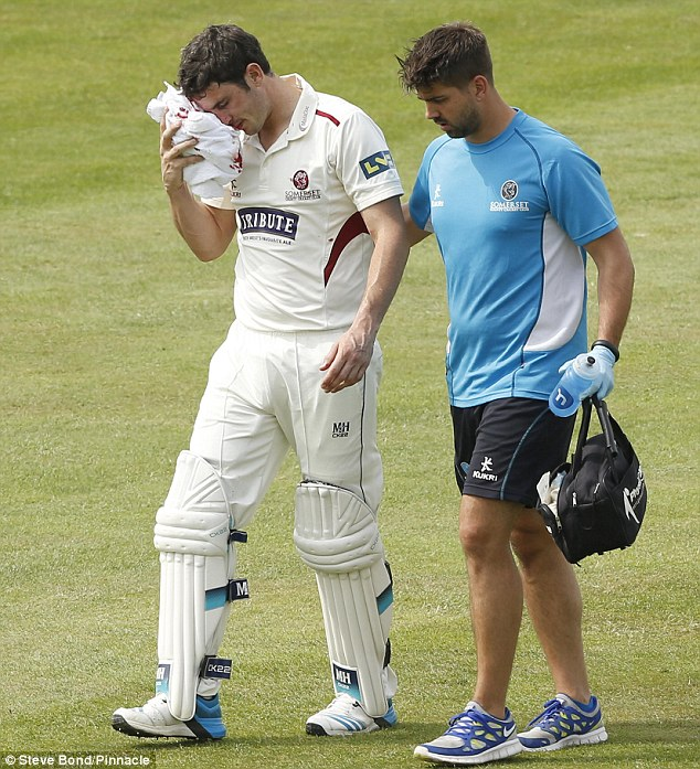 Down and out: Kieswetter (left) exited the field with his eye heavily compressed after scoring 14 runs