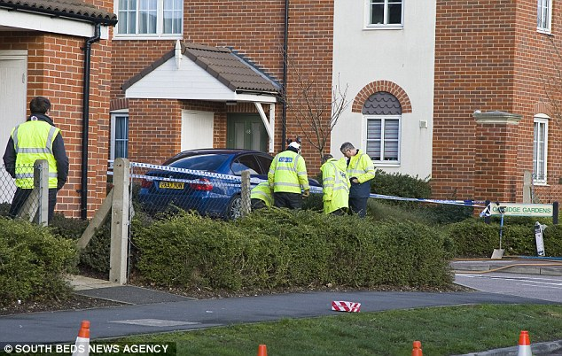 Investigation: Police have been at the scene since the sinkhole suddenly opened up at 7.30am today