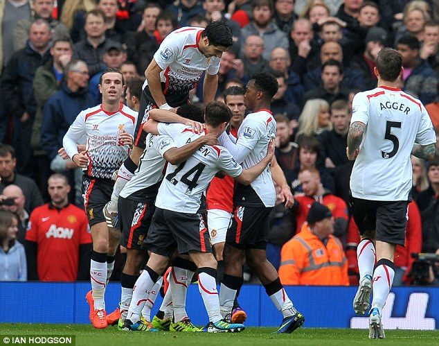 Moving on up: Liverpool players celebrate the win that takes them to second in the table