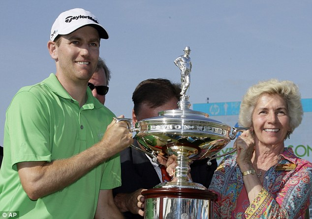Company: Todd poses with the trophy and Peggy Nelson, widow of tournament namesake Byron Nelson