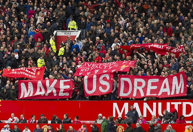 Make us dream: Liverpool fans are living the dream as they keep pace of the Premier League title race