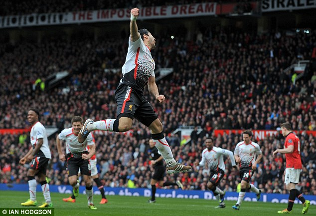 High flier: Suarez jumps for joy after completing United's latest humiliation at Old Trafford
