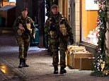 BRUSSELS, BELGIUM - NOVEMBER 23: Armed soldiers patrol along Rue Des Sols on November 23, 2015 in Brussels, Belgium. Security has been tightened in the nation's capital after police arrested sixteen suspected terrorists during more than 22 anti-terror raids around the city yesterday.  (Photo by Ben Pruchnie/Getty Images)