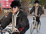 **ALL ROUND PICTURES FROM SOLARPIX.COM** **SOLARPIX RIGHTS-WORLDWIDE SYNDICATION**  ** NO SYNDICATION IN SPAIN**                                                                                  Caption: Pop Queen Madonna seen taking a quick Bike ride with her security and entourage before her concert toning in Barcelona Spain This pic:Madonna **NO ONLINE USAGE WITHOUT PRIOR AGREEMENT** JOB REF:18832       BJG  DATE:23.11.15 **MUST CREDIT SOLARPIX.COM AS CONDITION OF PUBLICATION** **CALL US ON: +34 952 811 768**