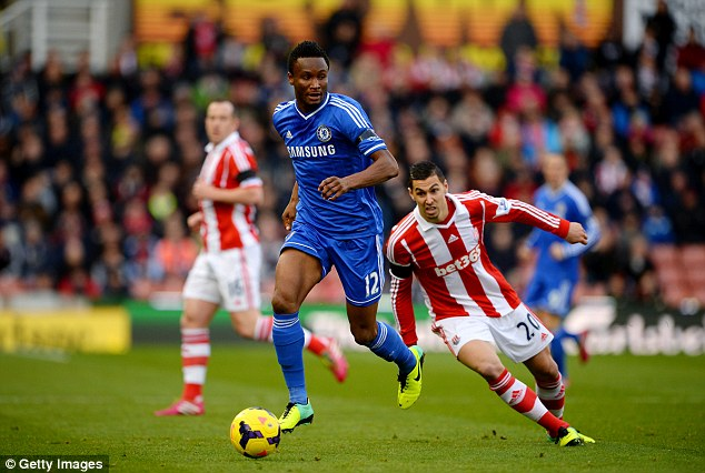 Looking for a pass: John Obi Mikel tries to get Chelsea moving