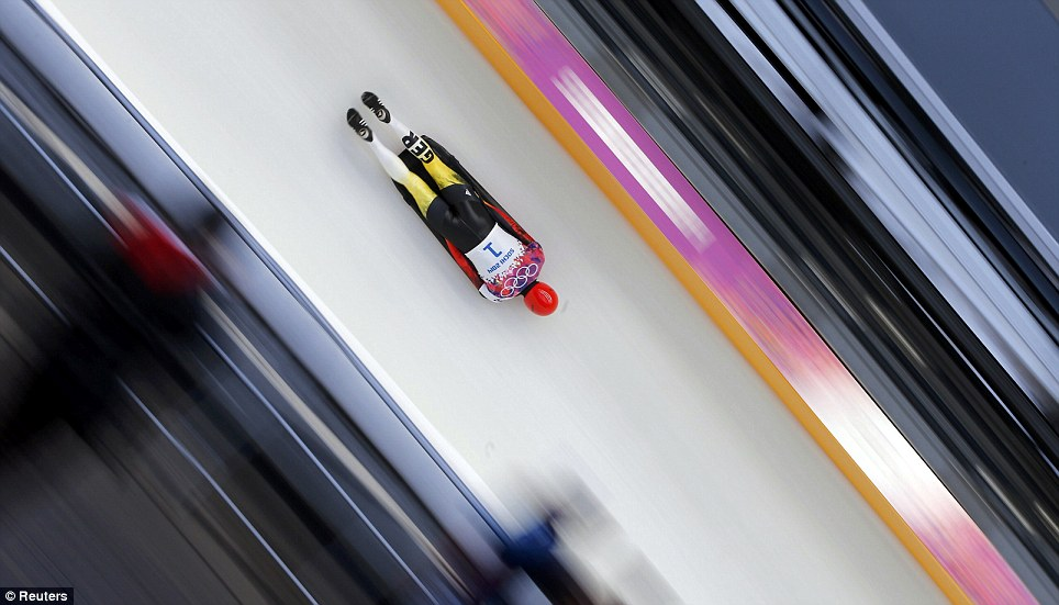 Forward Russia! Germany's Frank Rommel speeds down the track during the men's skeleton event in Sochi