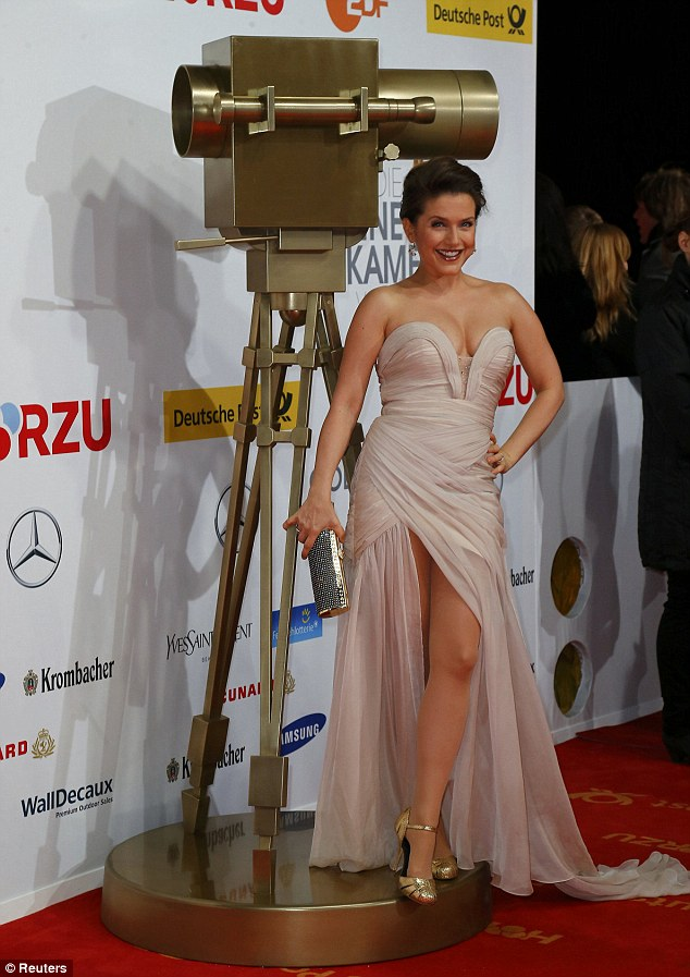 Racy: German singer  Jeanette Biedermann wore a leg and cleavage baring frock