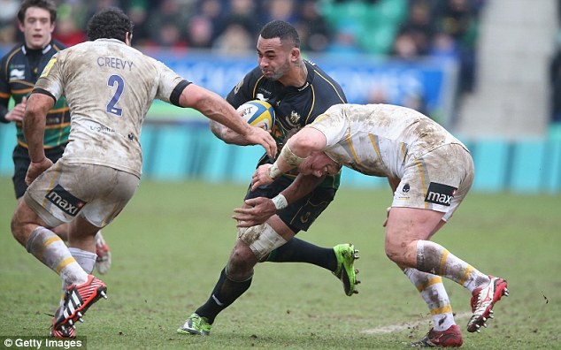 Force: Samu Manoa is tackled by Agustin Creevy and John Andress, but the Warriors lost their cool