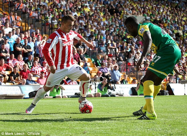 The Switzerland international (left) laid on for Mame Biram Diouf to score as the Potters drew 1-1 away