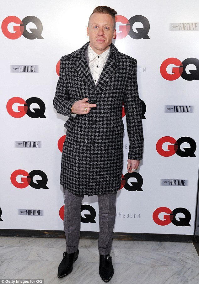 No more thrift shops: After taking home four Grammys on Sunday, Macklemore looked dapper in a smart houndstooth coat at the GQ party