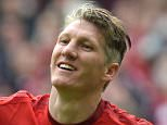 (FILES) - Picture on May 23, 2015 Bayern Munich's midfielder Bastian Schweinsteiger celebrating after the second goal during German first division Bundesliga football match FC Bayern Munich vs 1 FSV Mainz 05 at the Allianz Arena in Munich, southern Germany. Germany's captain Bastian Schweinsteiger is set to be re-united with his former coach Louis van Gaal at Manchester United, according to German daily Bild on July 11, 2015.   AFP PHOTO / CHRISTOF STACHECHRISTOF STACHE/AFP/Getty Images