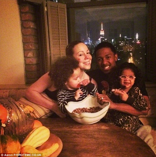 Happy family: The couple have two children, twins Moroccan and Monroe, pictured over Thanksgiving in NYC