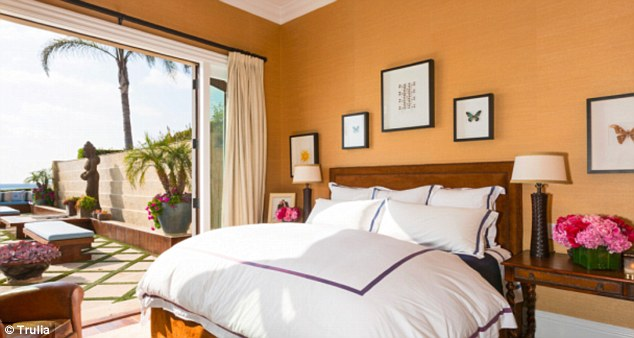 Lots of light: A bedroom opened to a patio with ocean view