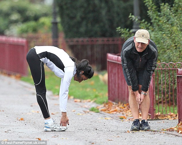 Flexible friend: Despite his efforts, the MP can't touch his toes