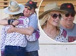 Please contact X17 before any use of these exclusive photos - x17@x17agency.com   Happy couple Neil Young, 70, and Daryl Hannah, 54, look so in love as they share a long hug during their grocery run in Malibu. November 22, 2015  X17online.com EXCLUSIVE