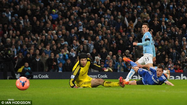 Pierced: The marksman slots passed Chelsea keeper Petr Cech and defender César Azpilicueta for 1-0
