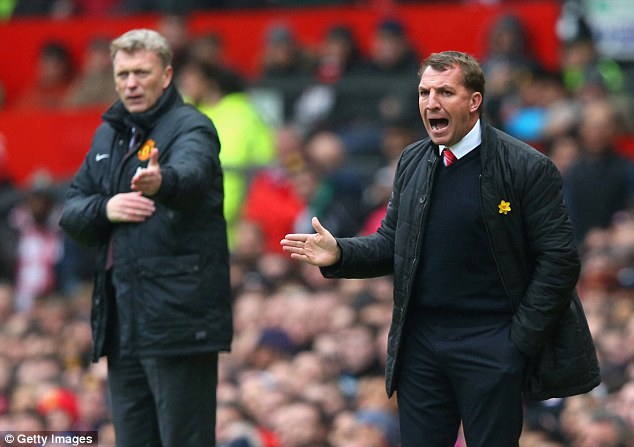Contrasting fortunes: Brendan Rodgers gestures during the match as Liverpool ran riot at Old Trafford