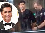 EXCLUSIVE: **NO USA TV, NO USA WEB, PREMIUM RATES APPLY** John Stamos is seen being placed under arrest for alleged DUI in Beverly Hills\\n\\nPictured: John Stamos\\nRef: SPL1046055  130615   EXCLUSIVE\\nPicture by: TMZ.com / Splash News\\n\\nSplash News and Pictures\\nLos Angeles:310-821-2666\\nNew York:212-619-2666\\nLondon:870-934-2666\\nphotodesk@splashnews.com\\n