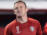 Manchester United's English forward Wayne Rooney (C) warms up prior to the UEFA Champions League group B football match between PFC CSKA Moscow and FC Manchester United at the Arena Khimki stadium outside Moscow on October 21, 2015. AFP PHOTO / YURI KADOBNOVYURI KADOBNOV/AFP/Getty Images