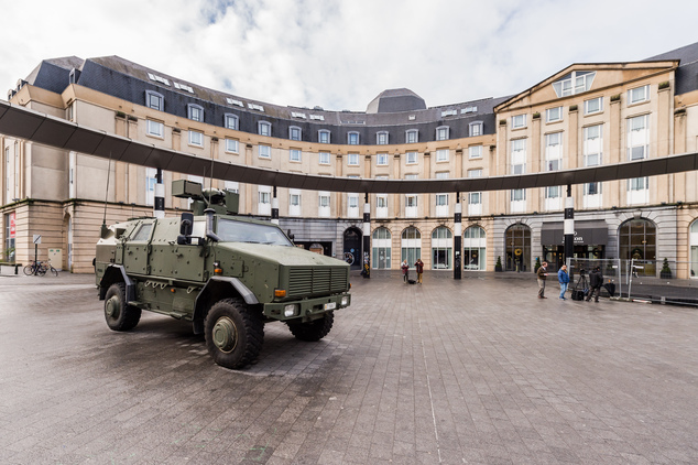 A Belgian Army vehicle is parked on the almost deserted square in front of the main train station in the center of Brussels on Sunday, Nov. 22, 2015. Western...